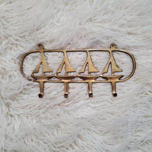 vintage brass sail boat hanger
